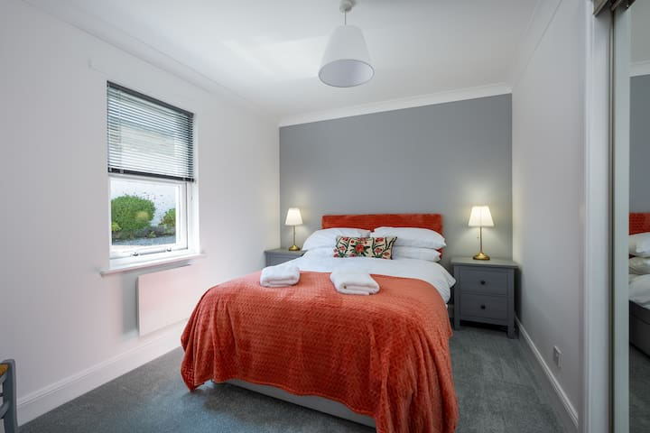 The master bedroom has plenty storage for all your holiday clothes in the fitted wardrobe.
