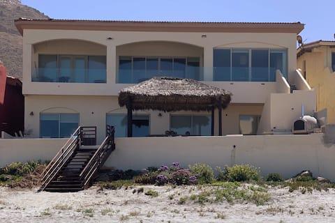 Beachfront home with panoramic ocean views.