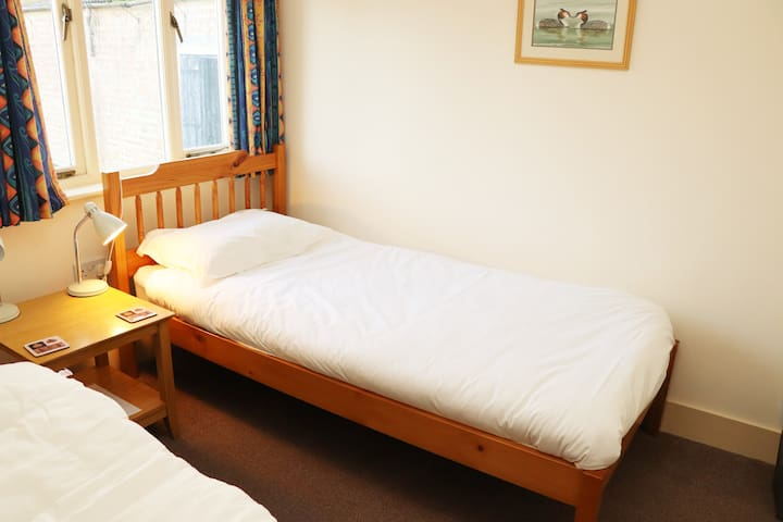 Comfortable twin bed room with good private shower and toilet.