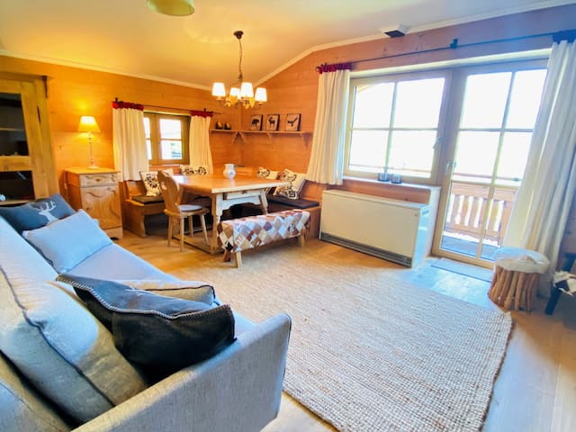 Living room with dining area and access to balcony.