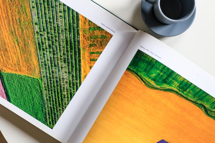 """Enjoy a cup of coffee while overlooking the """"Bird's eye view of Bulgaria"""" book.  It features 200+ aerial photos of Bulgaria, made by the famous photographer Alexander Ivanov."""