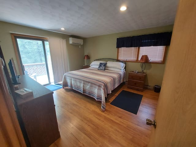 Master Bedroom w/ King bed, large walk in closet and TV.  See the private balcony with view of the woods!