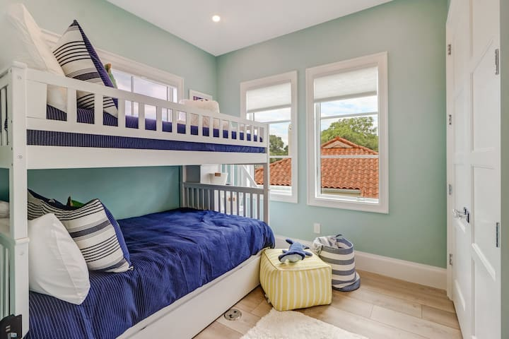 The upstairs bunk room with full bunk beds and a twin trundle bed.
