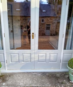 The cottage entrance is through double doors which are 60 inches wide.
