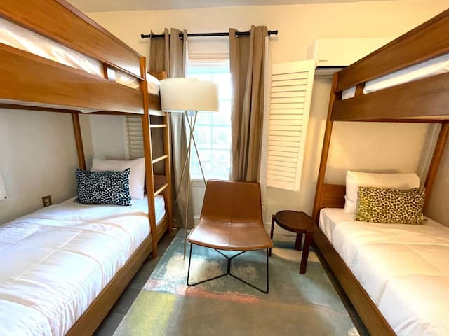 Third bedroom with two sets of twin beds.