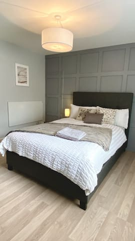 Brand new double bed and newly fitted panelling with his and hers wardrobe.