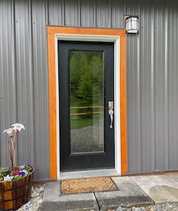"""Main entrance, does have a threshold to get over, with assistance. Door is 36"""" wide."""