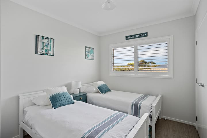 clean and comfortable bedroom with twin beds