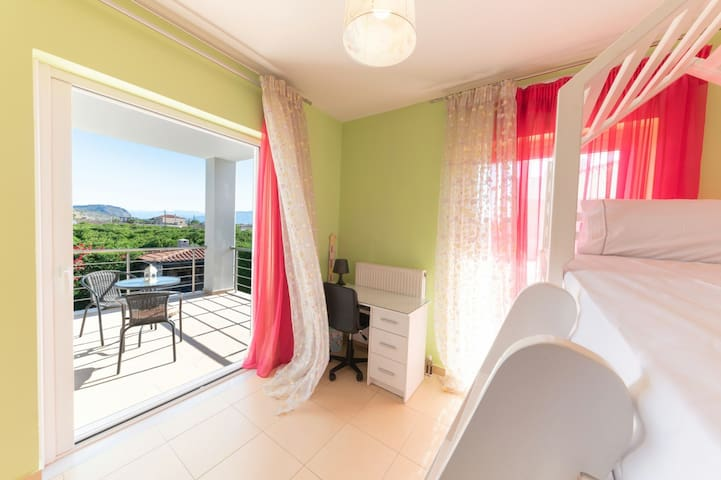 double bunk bed with balcony overlooking the pool and Palamidi castle