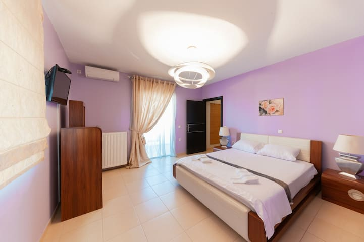 master bedroom with cloakroom, bathroom and private balcony
