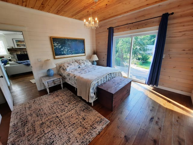 Gorgeous Master Bedroom with patio doors to back deck.
