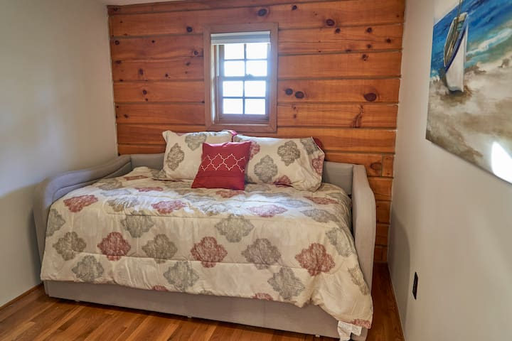Bedroom 3: Daybed with trundle (two twin mattresses). Second bed pulls out from beneath.