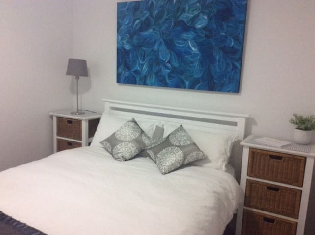 Main Bedroom with beautiful authentic Indigenous Art on display. Electric blankets and central heating provided. Large Built In Wardrobe provided.