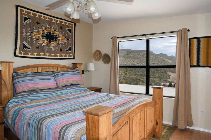 Master bedroom with outstanding views and southwest decor.