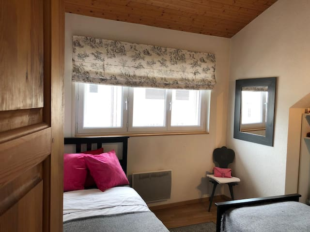 Comfotable twin bedroom with large wardrobe space.