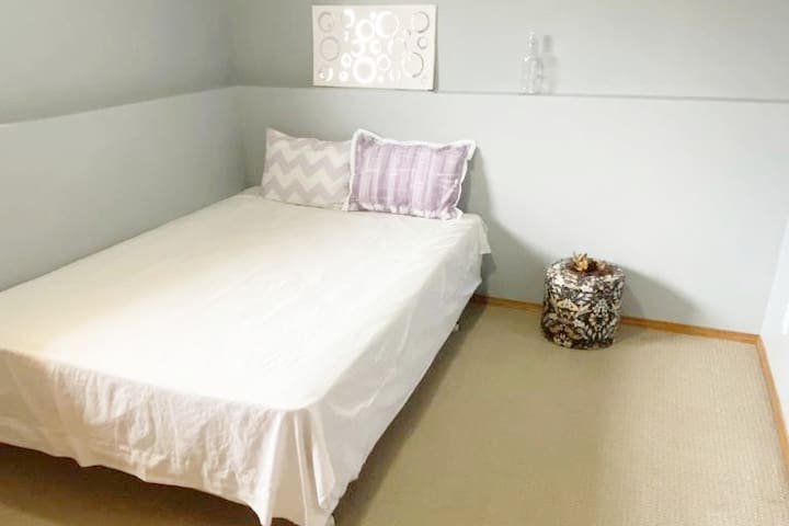 Bedroom 2: Neat Bedroom with newly purchased Queen size Firm Mattress and bed. Storage ottoman and decor to lighten the space.