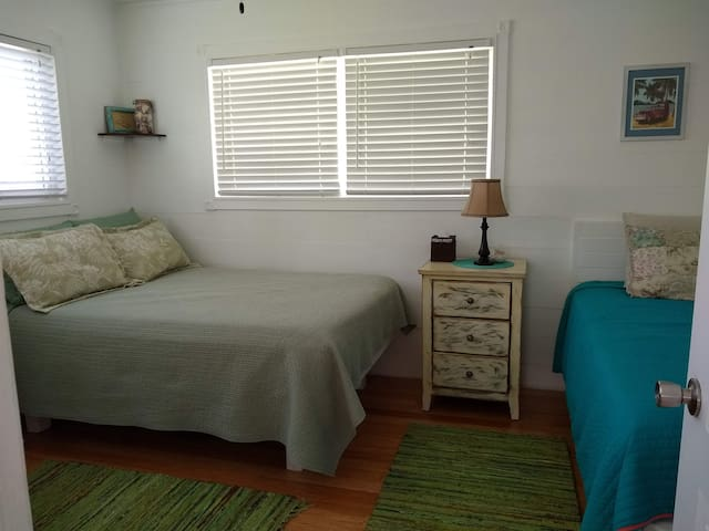 Second cozy bedroom offers a full and a twin bed - again with plenty of storage space.