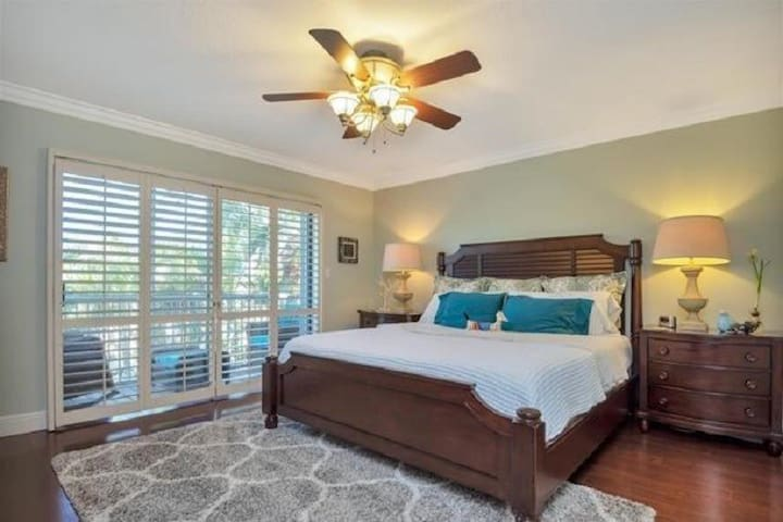 Master bedroom with private balcony overlooking garden.
