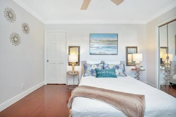 Guest bedroom with private bathroom, plenty of closet space, dresser, desk area, includes beautiful bedding and hangers.   There's an XL air mattress for use too.