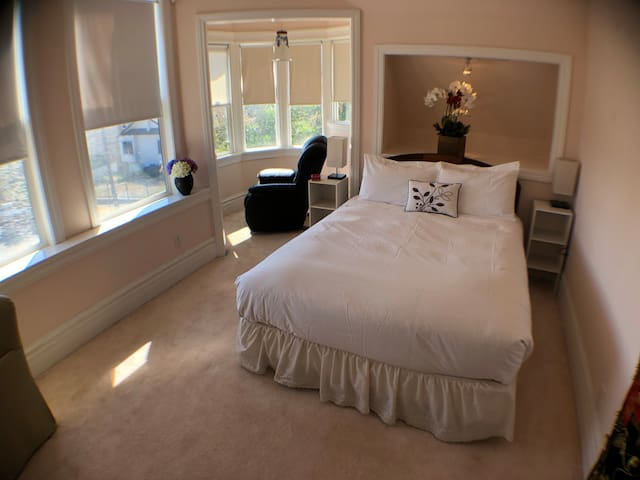 Spacious Master Bedroom, comfortable queen sized bed  for a restful sleep.  Lounge chair with 270 degree turret view.