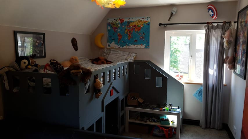 large kids bedroom with small sofa bed to sleep 2 children
