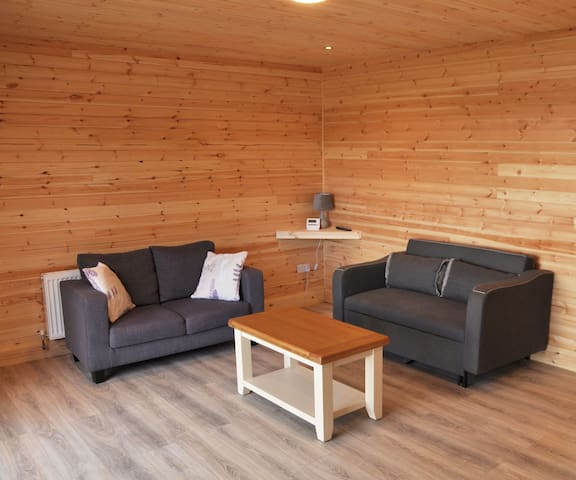 The living room consists of a sofa bed, settee and coffee table. There is free wifi throughout.