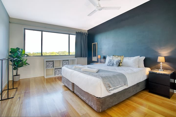 The third bedroom also has a premium queen-sized bed, bedside tables with reading lights and storage space for your belongings.