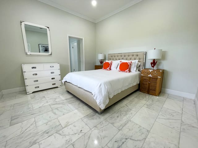 The master bedroom offers plenty of light and space, comes with a comfy queen-size bed, walk-in closet, and ensuite luxurious bathroom.