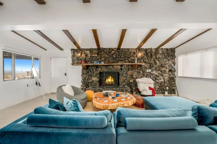Living room featuring original volcanic rock fireplace and custom coffee table