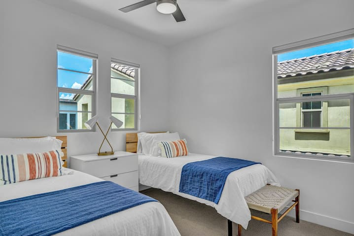 Twin bedroom. Silky soft, breathable, microfiber linens, room darkening shades, reach in closet with hangers and luggage rack.
