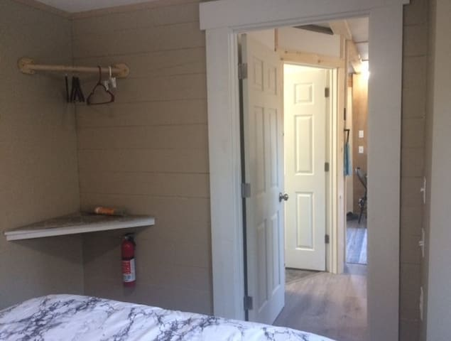 A view from the bedroom to the table in the kitchen.  The bathroom door is in between.
