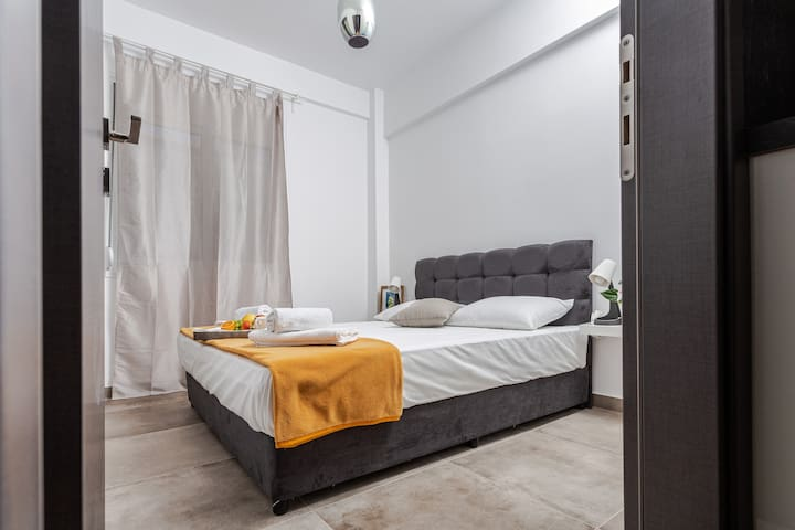 Bedroom with comfortable bed, socket near the bed, possible to put baby bed, wardrobe mirror