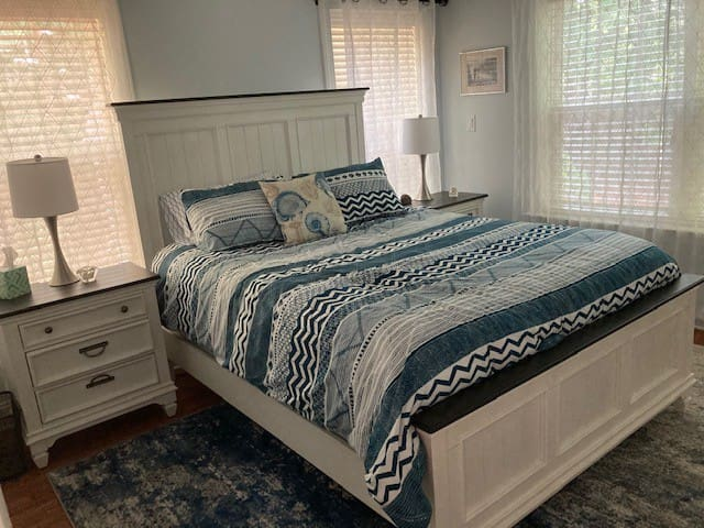 Master bedroom.  Room is surrounded outdoors by wooded area.