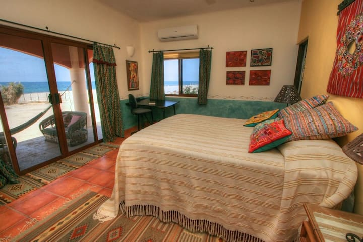 Master bedroom with covered outdoor sitting area and direct views of the beach and Sea of Cortez.  Extremely comfortable queen bed, AC, private master bath.