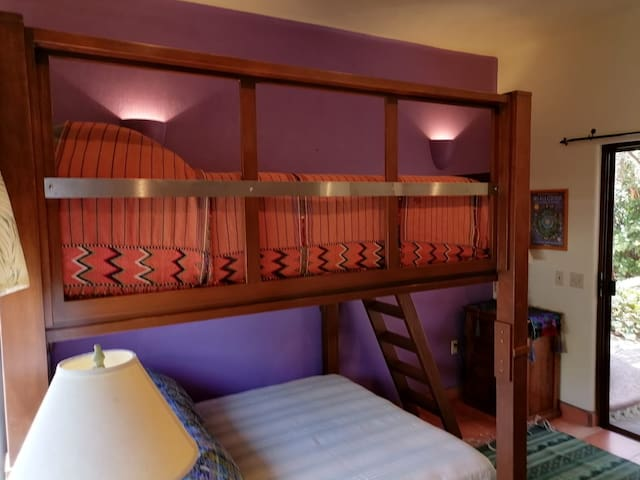 Bunk room has two very comfortable queen bunks, AC.  Access to interior courtyard and protected sitting area.