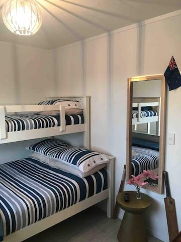 2nd Bedroom has fabulous bunk beds, double with single above, both have very comfortable mattresses and fresh linen is provided