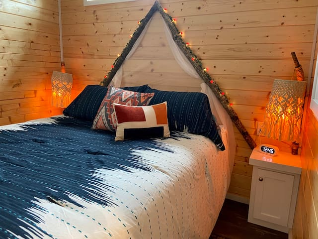 This master bedroom makes it easy to unwind after a long day, with its serene camp theme. Featuring a firelight glow to help you fall right asleep.