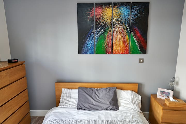 Great art to brighten up the place. Lots of light in this bedroom. All bedding is 100% cotton.