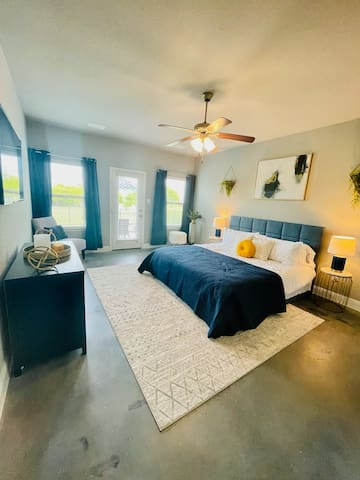Master Bedroom with large TV. Private entry/exit to backyard/lake.
