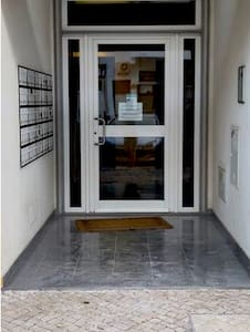 Entrance to the lobby is wide and flat. There lift is small but can accommodate someone with a 4 wheeled mobility scooter.