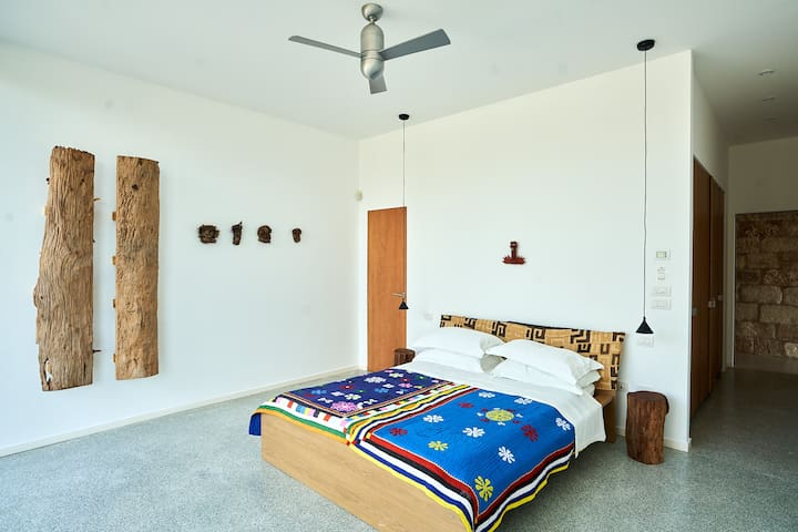The middle bedroom has its own on-suite bathroom. If you are two people on the booking we just open one of the rooms: the default being the master bedroom. If you would prefer this room and its shower then request this room instead.