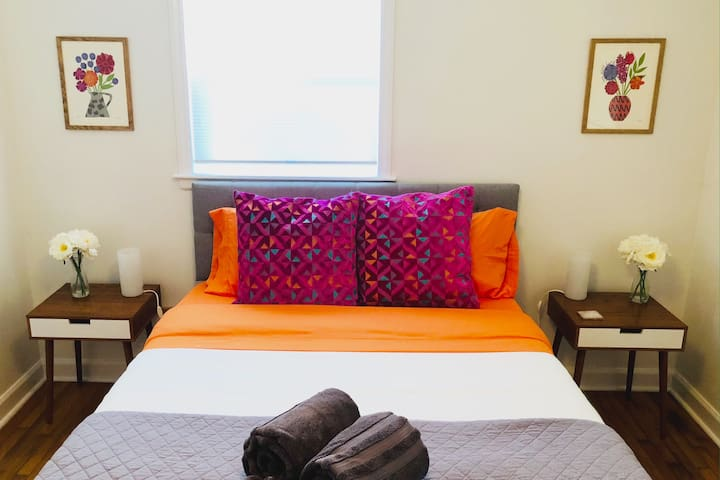 Our warm and inviting Queen bedroom welcomes you after a day of exploring Asheville and activities :)
