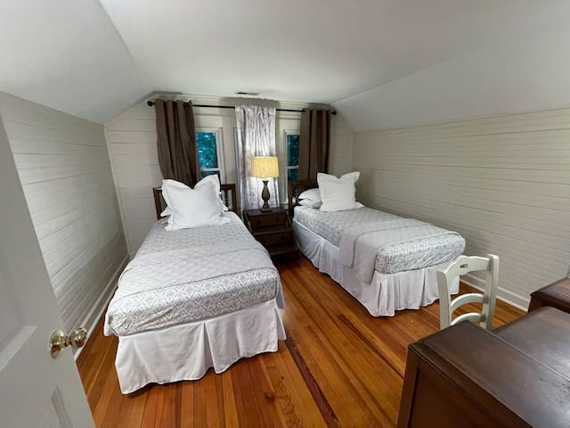 Guest room - upstairs. Features 2 twin beds and shares a full bathroom with the upstairs areas. Hayes House at Old Haigler Inn, Mint Hill, NC