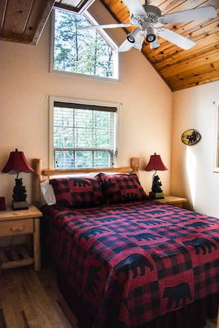 Guest room with queen bed and loft