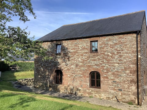 Spacious barn in extensive grounds.