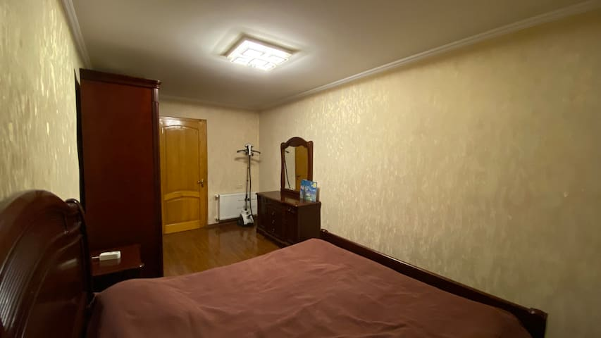 """bedroom with a """"Qeen size"""" double bed, Vaporizer"""