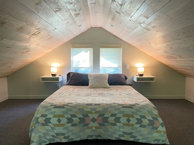 Upstairs loft bedroom with a queen bed