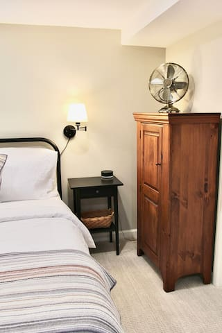 Bedside cabinet to store extra linens or personal belongings. Fan for maximum comfort.