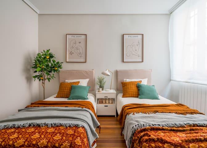 Habitación con camas individuales.