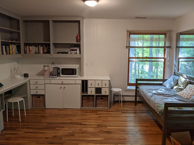 Twin daybed / sofa and kitchenette and workspace. Note that this picture is not complete yet. TV with Roku is available with request but not stored in the suite at all times.
